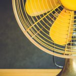 Bright yellow fan in a a room