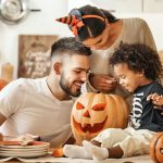 Family enjoying Halloween in the comfort of their home.